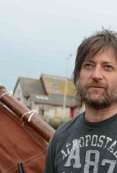 "King Creosote Brings Scottish Lilt to Gorgeous Cover of Cher's ""Believe"""