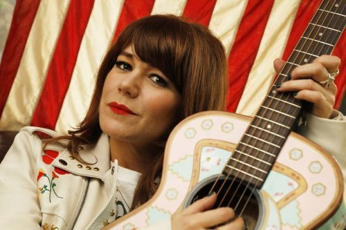 jenny lewis standing in the doorway
